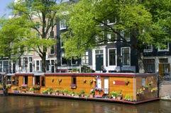 amsterdam łodzi kanału kwiaty Holland house Obrazy Stock