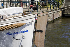 Amsterdam. Boat anchored in a canal in Amsterdam royalty free stock photography