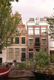 Amsterdam. One ofthe canals in the center of Amsterdam with houses and boats Royalty Free Stock Photography