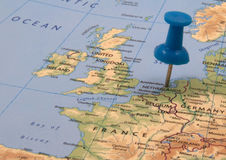 Amsterdam. Blue push pin on a map, indicating the position of Amsterdam, The Netherlands royalty free stock photos