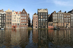 Amsterdam. Canal houses and their reflections in Amsterdam royalty free stock image