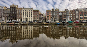Amsterdam. Houses in Amsterdam near the river, Holland Royalty Free Stock Image