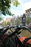Amsterdam. Bikes parked along a canal in Amsterdam royalty free stock images