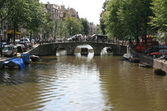 Amsterdam. A bridge over a canal in Amsterdam royalty free stock image