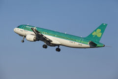 Amsterdam Airport Schiphol - Aer Lingus Airbus A320 takes off. The Aer Lingus Airbus A320-214 with identification EI-DEC takes off at Amsterdam Airport Schiphol stock photography