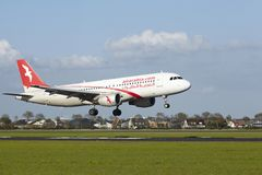 Amsterdam Airport Schiphol - A320 of Air Arabia Maroc lands. An Airbus A320-214 of Air Arabia Maroc lands at Amsterdam Airport Schiphol (The Netherlands, AMS) on Royalty Free Stock Photography