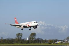 Amsterdam Airport Schiphol - A320 of Air Arabia Maroc lands. An Airbus A320-214 of Air Arabia Maroc lands at Amsterdam Airport Schiphol (The Netherlands, AMS) on Stock Photography