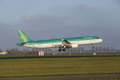 Amsterdam Airport Schiphol - Air Lingus Airbus A321 lands. The Air Lingus Airbus A321-211 with identification EI-CPE lands at Amsterdam Airport Schiphol The royalty free stock images