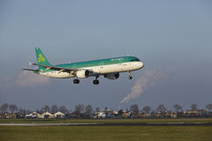 Amsterdam Airport Schiphol - Air Lingus Airbus A321 lands. The Air Lingus Airbus A321-211 with identification EI-CPE lands at Amsterdam Airport Schiphol The royalty free stock image