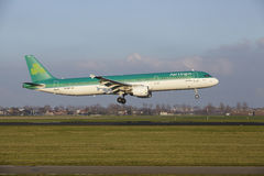 Amsterdam Airport Schiphol - Air Lingus Airbus A321 lands. The Air Lingus Airbus A321-211 with identification EI-CPE lands at Amsterdam Airport Schiphol The royalty free stock photos
