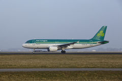 Amsterdam Airport Schiphol - Airbus 320 of Aer Lingus takes off Royalty Free Stock Images