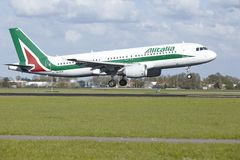 Amsterdam Airport Schiphol - Airbus A320 of Alitalia lands Royalty Free Stock Image