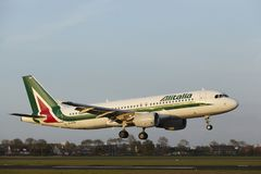 Amsterdam Airport Schiphol - Airbus A320 of Alitalia lands Royalty Free Stock Photo