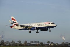 Amsterdam Airport Schiphol - Airbus A320 of British Airways lands Royalty Free Stock Photo