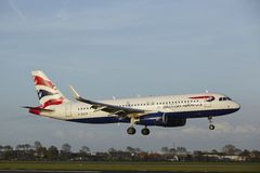 Amsterdam Airport Schiphol - Airbus A320 of British Airways lands Royalty Free Stock Images