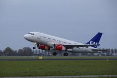 Amsterdam Airport Schiphol - Airbus A319 of SAS Scandinavian Airlines takes off Royalty Free Stock Images