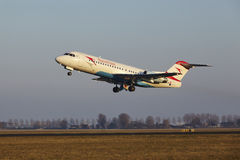 Amsterdam Airport Schiphol - Austrian Airlines Fokker 70 Takes Off Stock Photography