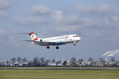 Amsterdam Airport Schiphol - Austrian Airlines Fokker 100 lands Royalty Free Stock Photo