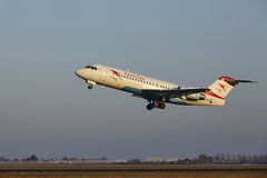 Amsterdam Airport Schiphol - Austrian Airlines Fokker 70 takes off Stock Photo