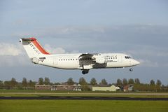 Amsterdam Airport Schiphol - Avro RJ85 of CityJet lands Stock Image