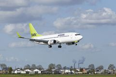 Amsterdam Airport Schiphol - Boeing 737 Of Air Baltic Lands Royalty Free Stock Images