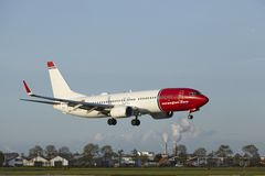 Amsterdam Airport Schiphol - Boeing 737 of Norwegian lands Royalty Free Stock Photo
