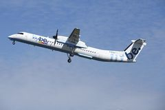 Amsterdam Airport Schiphol - Bombardier Dash 8 of Flybe takes off Stock Photography