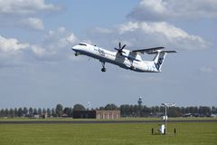 Amsterdam Airport Schiphol - Bombardier Dash 8 of Flybe takes off Royalty Free Stock Photo