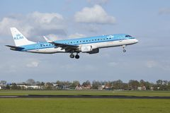 Amsterdam Airport Schiphol - Embraer ERJ-190 of KLM Cityhopper lands Royalty Free Stock Image