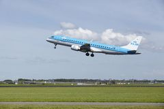 Amsterdam Airport Schiphol - Embraer ERJ-190 of KLM Cityhopper takes off Royalty Free Stock Photo