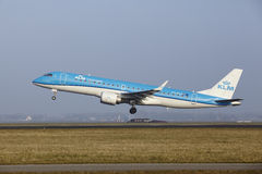 Amsterdam Airport Schiphol - Embraer ERJ-190 of KLM Cityhopper takes off Stock Image