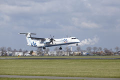 Amsterdam Airport Schiphol - Flybe Bombardier Dash 8 lands. The Flybe Bombardier Dash 8 Q400 with identification G-JECL lands at Amsterdam Airport Schiphol The royalty free stock photography
