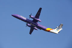 Amsterdam Airport Schiphol - Flybe Bombardier Dash takes off Royalty Free Stock Photos