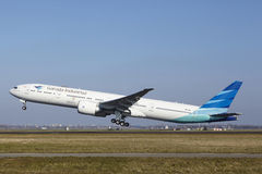Amsterdam Airport Schiphol - Garuda Indonesia Boeing 777 takes off. The Garuda Indonesia Boeing 777-3U3(ER) with identification PK-GIC takes off at Amsterdam Stock Photo