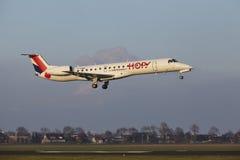 Amsterdam Airport Schiphol - HOP Embraer 145 lands. The HOP! Embraer ERJ-145MP with identification F-GUBG lands at Amsterdam Airport Schiphol The Netherlands Stock Images