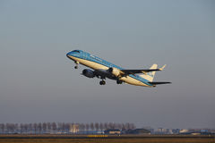 Amsterdam Airport Schiphol - KLM Cityhopper Embraer 190 takes off Royalty Free Stock Photos