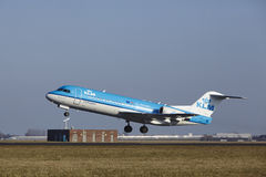 Amsterdam Airport Schiphol - KLM Cityhopper Fokker 70 takes off Royalty Free Stock Images