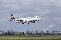 Amsterdam Airport Schiphol - Lufthansa CityLine Embraer 195 lands Royalty Free Stock Images