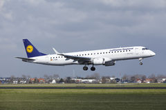 Amsterdam Airport Schiphol - Lufthansa CityLine Embraer 195 lands Royalty Free Stock Photo