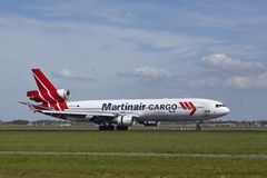 Amsterdam Airport Schiphol - MD-11 of Martinair Cargo lands Royalty Free Stock Image