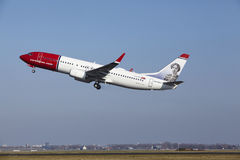 Amsterdam Airport Schiphol - Norwegian Airlines Boeing 737 takes off. The Norwegian Airlines Boeing 737-8JP (Sigrid Undset Livery) with identification LN-NGY Royalty Free Stock Photos