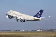 Amsterdam Airport Schiphol - Saudia Cargo Boeing 747 takes off Royalty Free Stock Image