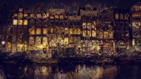 Amsterdam alloggia la vista attraverso il vetro con le gocce di pioggia Fotografia Stock