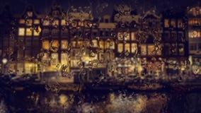 Amsterdam alloggia la vista attraverso il vetro con le gocce di pioggia Fotografia Stock Libera da Diritti