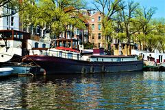 Amsterdam, Amstel river, boats, Netherlands, Europe and colorful buildings royalty free stock images