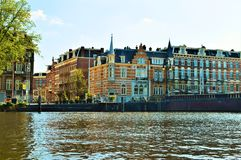 Amsterdam, Amstel river, Netherlands, Europe and colorful buildings royalty free stock images