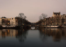 Amsterdam Amstel river at sunrise. View across the Amstel river of Amsterdam at sunrise Royalty Free Stock Photography