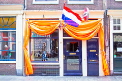 AMSTERDAM - APR 27: Decorated dutch cafe in Amsterdam at Kings D Royalty Free Stock Images
