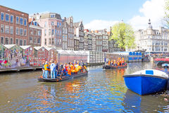 AMSTERDAM - APR 27: People celebrating Kings Day in Amsterdam on Stock Photo