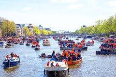 AMSTERDAM - APR 27: People celebrating Kings Day in Amsterdam on Royalty Free Stock Photography